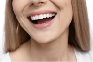 Patient smiling after her appointment for cosmetic dentistry in Chelsea MA.