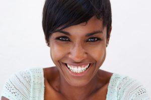 Dental patient happy with dental restoration procedure.