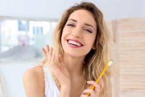 Woman taking care of her new dental veneers in Chelsea MA.