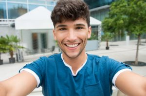 Young man happy with periodontal therapy for gum treatment in Chelsea MA.